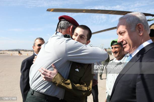 In this handout photo provided by the Israeli Defence Force freed Israeli soldier Gilad Shalit is greeted by IDF Chief of General Staff Benny Gantz...