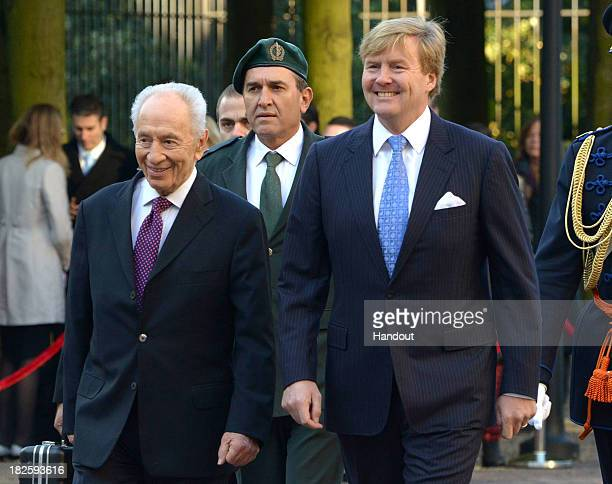 In this handout photo provided by the Israeli Government Press Office Israeli President Shimon Peres meets with Dutch King Alexander on October 1...