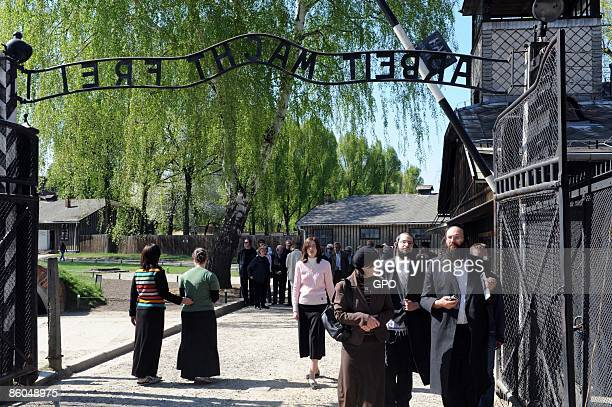 In this handout photo provided by the Israeli Government Press Office Jewish people gather at AuschwitzBirkenau on the eve of Yom Hashoa day on April...