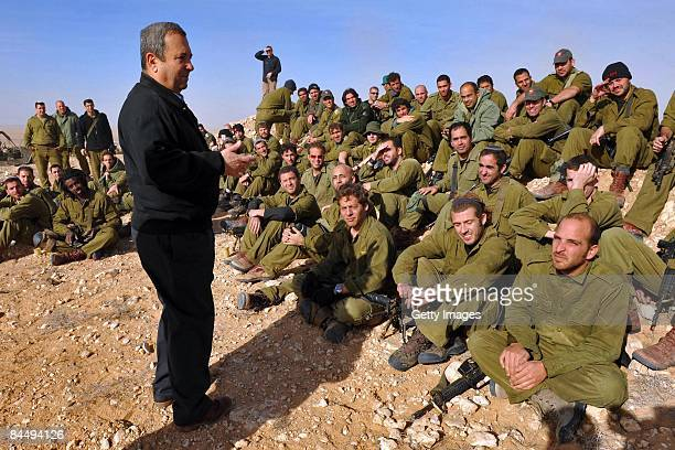 In this handout photo provided by the Israeli Ministry of Defense Israeli Defense Minister Ehud Barak meets with army reservists at a training base...