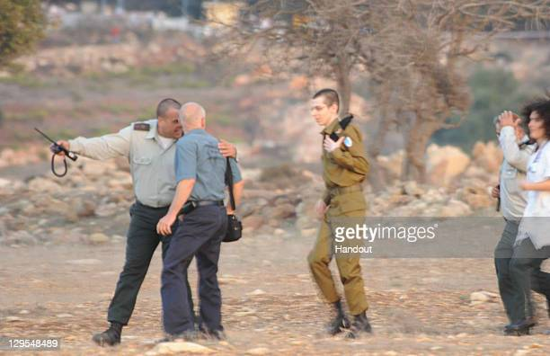 In this handout photo provided by the Israeli Police freed Israeli soldier Gilad Shalit and his father Noam arrive at their home town on October 18...