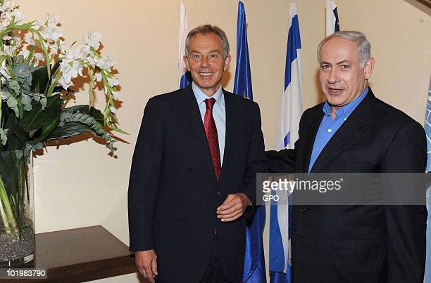In this handout photo provided by the Israeli Press Office Israeli Prime Minister Benjamin Netanyahu greets Middle East Quartet Envoy Tony Blair on...