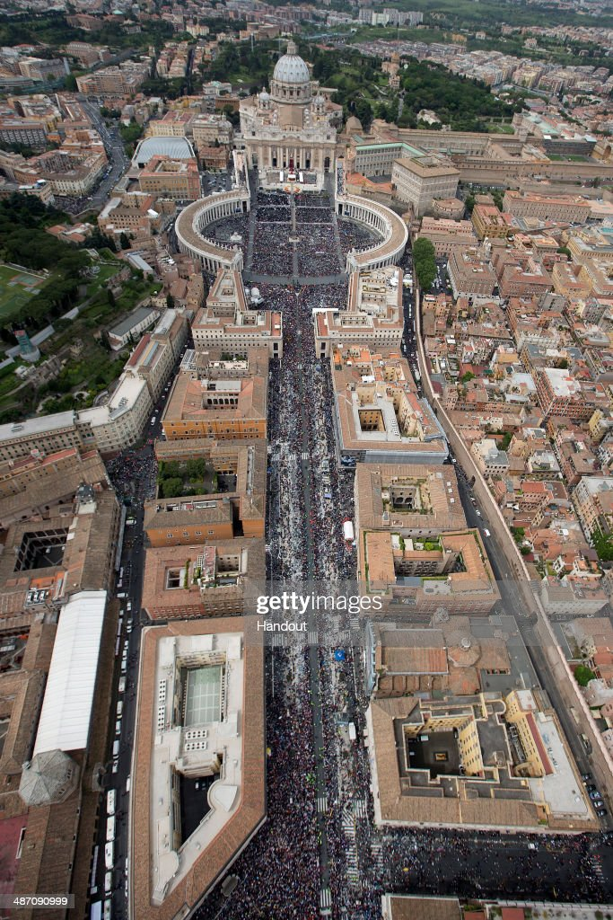 In this handout photo provided by the Italian National Police, an aerial view of St. Peter's Square and Via della Conciliazione is seen as Pope Francis leads a Canonization Mass in which John Paul II and John XXIII are to be declared saints on April 27, 2014 in Vatican City, Vatican. Dignitaries, heads of state and Royals from around the world attended the canonisations in the Vatican today.