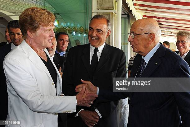 In this handout photo provided by the Italian Presidency press office President Giorgio Napolitano meets director Robert Redford and director of the...