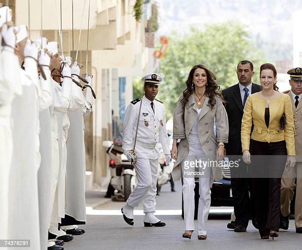 In this handout photo provided by the Jordanian Royal Court Queen Rania of Jordan and Princess Lalla Salma of Morocco the wife of Morocco's King...