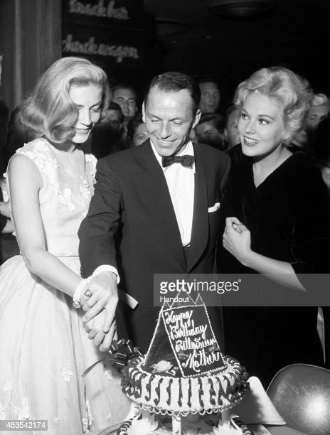 In this handout photo provided by the Las Vegas News Bureau Archives, Lauren Bacall, Frank Sinatra and Kim Novak are seen at the Sands Hotel on...