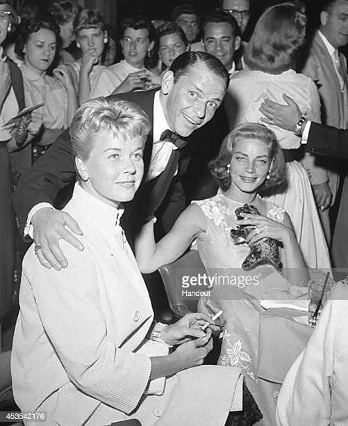 In this handout photo provided by the Las Vegas News Bureau Archives Doris Day Frank Sinatra and Lauren Bacall are seen at the Sands Hotel on...