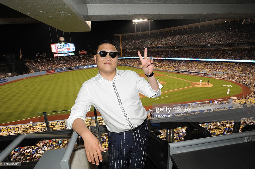 In this handout photo provided by the Los Angeles Dodgers, Psy attends the Cincinnatti Reds versus Los Angeles Dodgers game at Dodger Stadium on July 27, 2013 in Los Angeles, California.