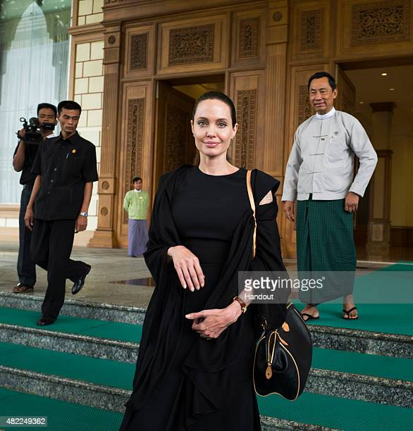 In this handout photo provided by the Maddox Jolie-Pitt Foundation, actress and activist Angelina Jolie Pitt leaves the Myanmar Parliament building...