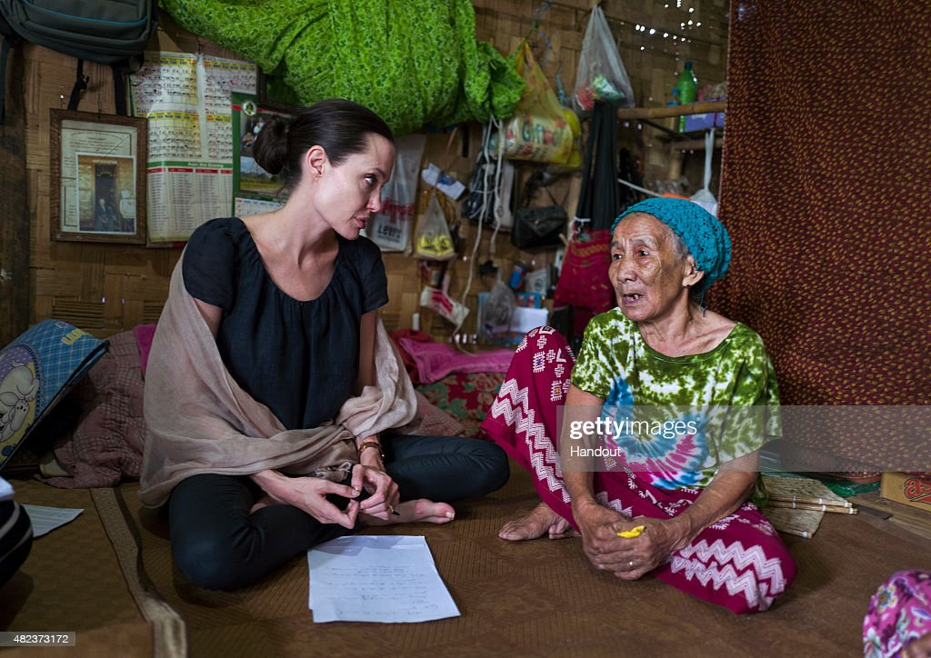 In this handout photo provided by the Maddox Jolie-Pitt Foundation, actress and activist Angelina Jolie Pitt meets meets a 90 year old woman during a visit to Ja Mai Kaung Baptist refugee camp on July 30, 2015 in Myitkyina, Myanmar. Angelina Jolie Pitt is a Special Envoy of UN High Commissioner for Refugees since her 2012 appointment.