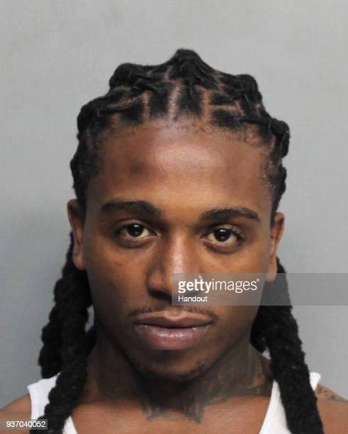 In this handout photo provided by the MiamiDade Police Department singer Jacquees is seen in a police booking photo after his arrest on charges of...