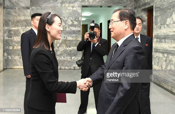 In this handout photo provided by the Ministry of Unification Kim YoJong sister of North Korean leader Kim Jong Un shakes hands with Chung Euiyong...