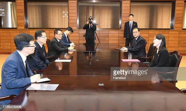 In this handout photo provided by the Ministry of Unification Kim YoJong sister of North Korean leader Kim Jong Un talks with Chung Euiyong South...