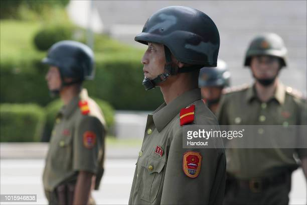 In this handout photo provided by the Ministry of Unification North Korea soldiers stand guard at the border village of Panmunjom during high level...