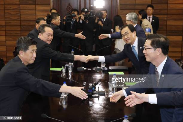 In this handout photo provided by the Ministry of Unification South Korean Unification Minister Cho MyoungGyon shakes hands with his North Korean...