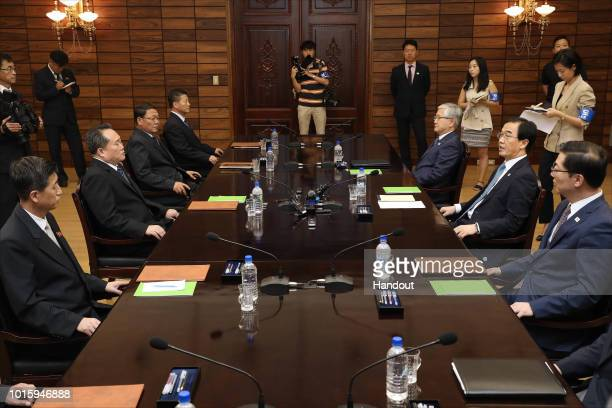 In this handout photo provided by the Ministry of Unification South Korean Unification Minister Cho MyoungGyon talks with his North Korean...