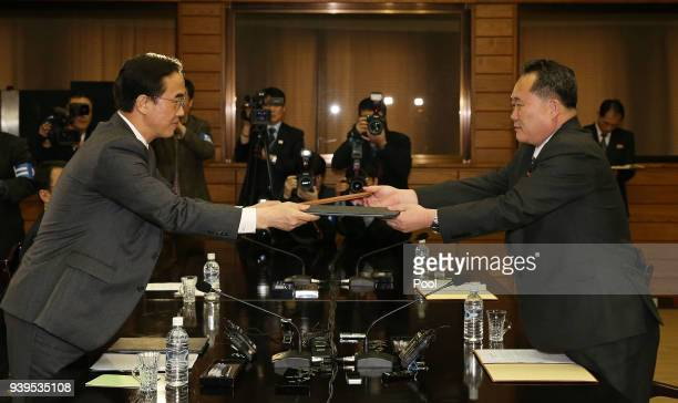 In this handout photo provided by the Ministry of Unification South Korean Unification Minister Cho MyoungGyon and North Korean delegation head Ri...