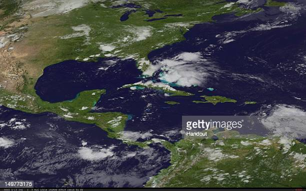 In this handout photo provided by the National Oceanic and Atmospheric Administration Tropical Storm Ernesto a tropical low off of Florida is tracked...
