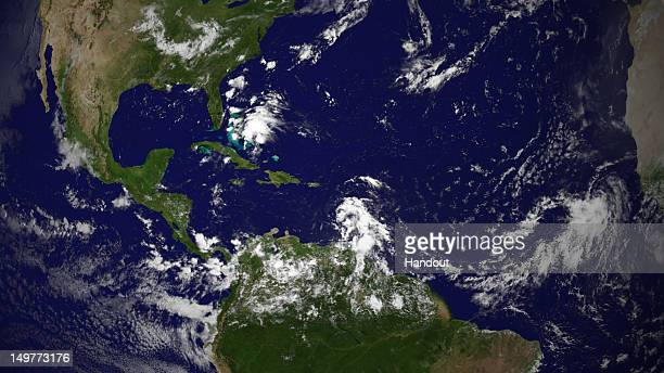 In this handout photo provided by the National Oceanic and Atmospheric Administration Tropical Storm Ernesto a tropical low off of Florida and a...