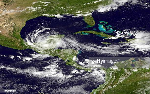 In this handout photo provided by the National Oceanic and Atmospheric Administration Tropical Storm Ernesto moves west as it moves over land in the...