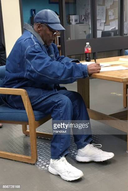 In this handout photo provided by the Nevada Department of Corrections OJ Simpson signs paperwork before his release from Lovelock Correctional...