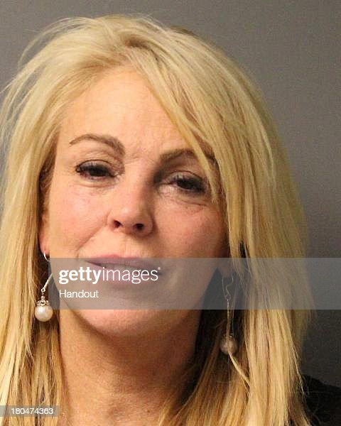 In this handout photo provided by the New York State Police, Dina Lohan is seen in a police booking photo after her arrest for DWI, Driving While Intoxicated, and speeding September 12, 2013 in Oyster Bay, New York. Lohan was issued traffic tickets for the offenses and later released. She is scheduled to appear in court September 24.