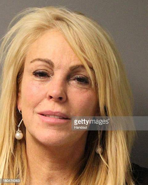 In this handout photo provided by the New York State Police Dina Lohan is seen in a police booking photo after her arrest for DWI Driving While...