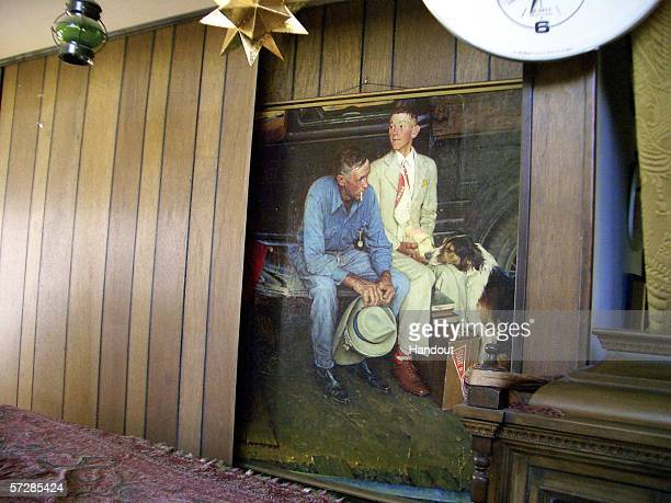 """In this handout photo provided by the Norman Rockwell Museum, the orginal Norman Rockwell painting entitled """"Breaking Home Ties"""" sits behind the fake..."""