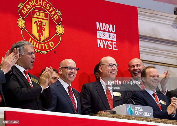 In this handout photo provided by the NYSE Euronext Manchester United Executives Joel Glazer and Avram Glazer and Ed Woodward prepare to ring the...