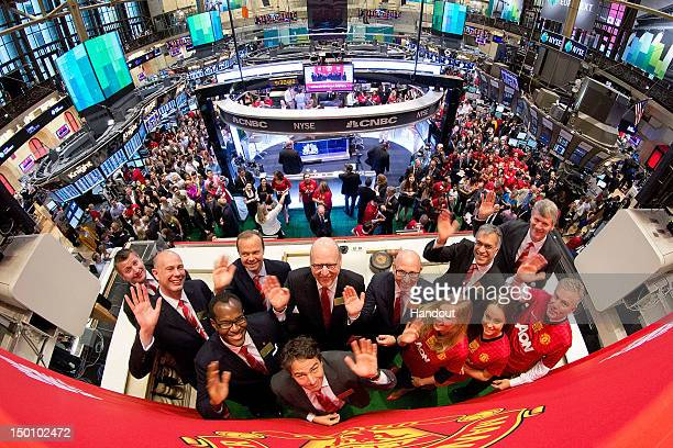 In this handout photo provided by the NYSE Euronext Manchester United Executives David Gill Joel Glazer and Avram Glazer with Ed Woodward prepare to...