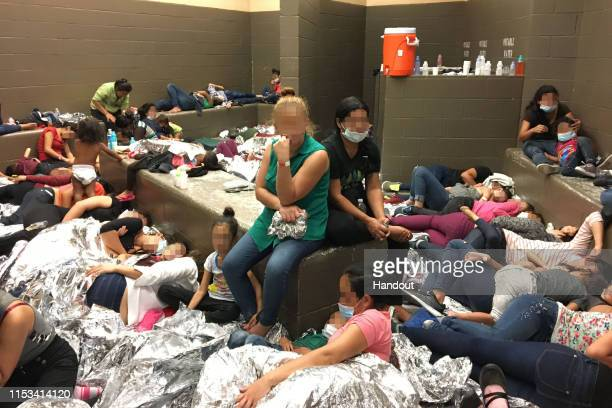 In this handout photo provided by the Office of Inspector General overcrowding of families is observed by OIG at US Border Patrol Weslaco Station on...
