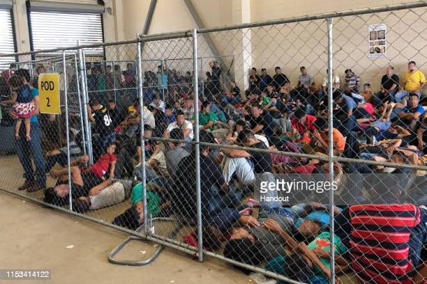 In this handout photo provided by the Office of Inspector General overcrowding of families is observed by OIG at US Border Patrol McAllen Station on...