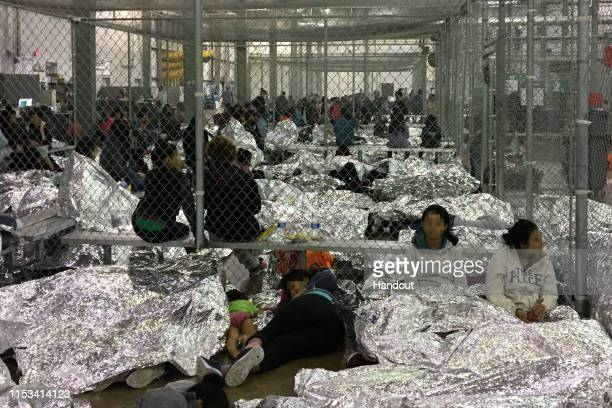 In this handout photo provided by the Office of Inspector General, overcrowding of families is observed by OIG at the U.S. Border Patrol McAllen...