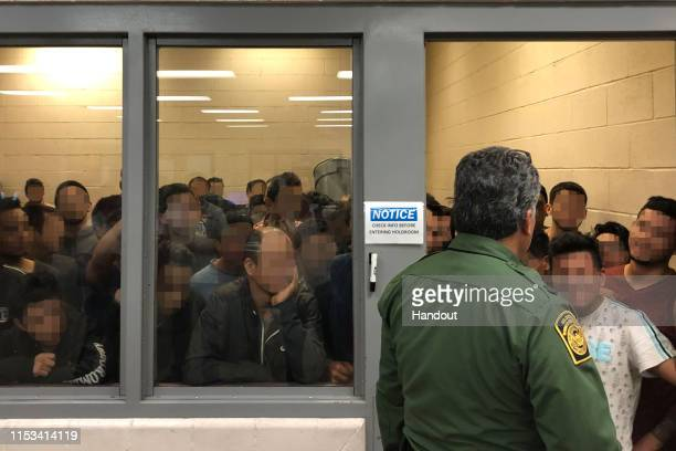 In this handout photo provided by the Office of Inspector General, adult males are detained in a cell with standing room only, as observed by OIG at...