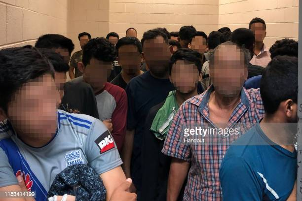 In this handout photo provided by the Office of Inspector General adult males are detained in a cell with standing room only as observed by OIG at US...