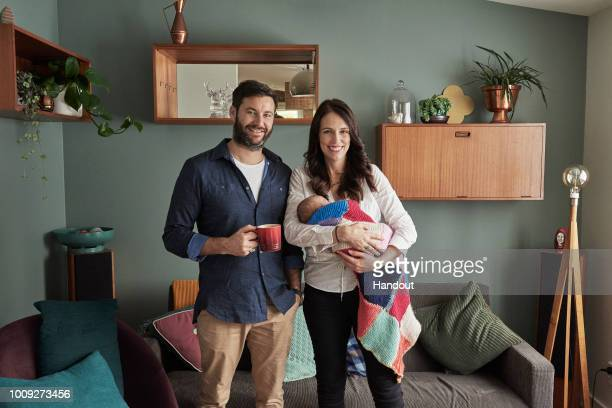 In this handout photo provided by the Office of the Prime Minister of New Zealand Prime Minister Jacinda Ardern and partner Clarke Gayford pose with...