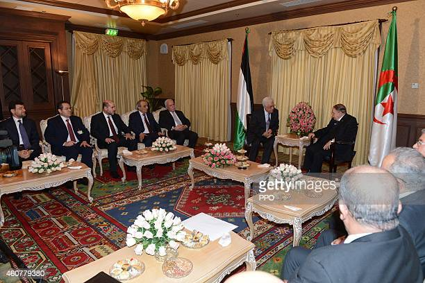 In this handout photo provided by the Palestinian Press Office Palestinian President Mahmoud Abbas during a meeting with Algerian President Abdelaziz...