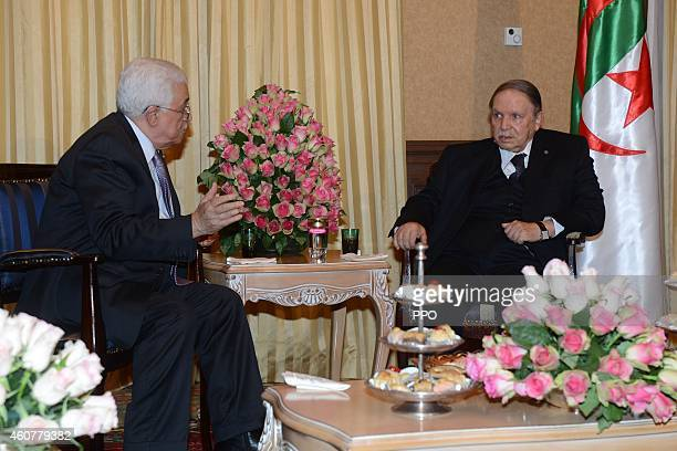 In this handout photo provided by the Palestinian Press Office , Palestinian President, Mahmoud Abbas during a meeting with Algerian President,...