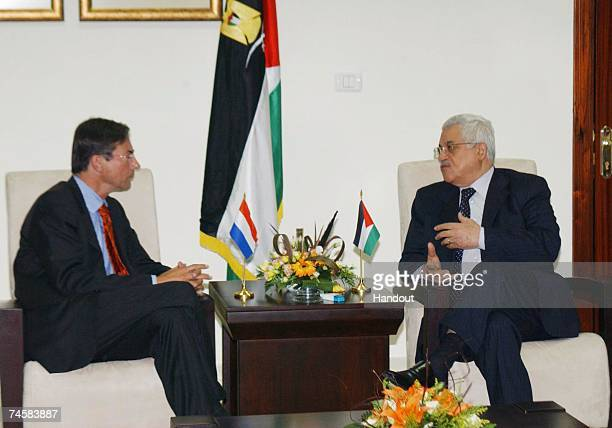 In this handout photo provided by the Palestinian Press Office President of the Palestinian National Authority Mahmoud Abbas talks with Maxime...