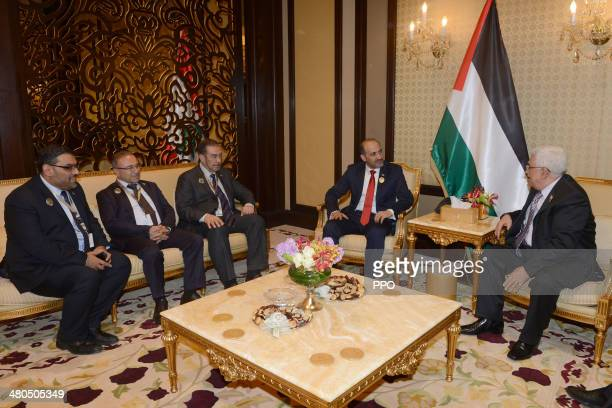 In this handout photo provided by the Palestinian Press Office Palestinian President Mahmoud Abbas meets with Syrian opposition coalition chairman...