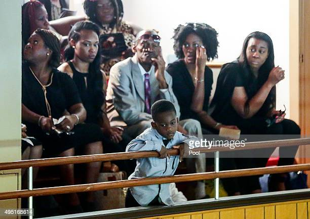 In this handout photo provided by the Palm Beach Post A little boy watches the proceedings below from the balcony during the funeral for Corey Jones...