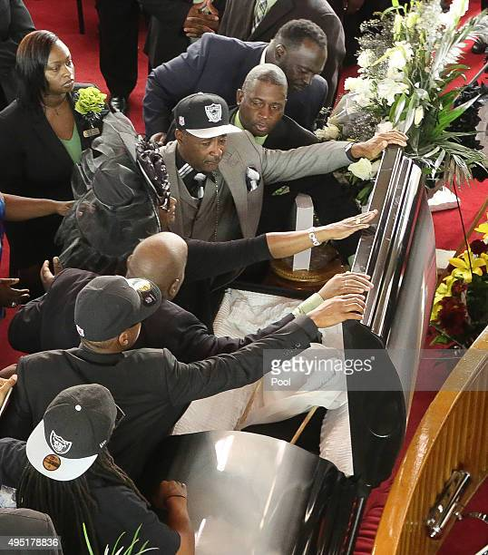 In this handout photo provided by the Palm Beach Post family members prepare to close the casket during the funeral for Corey Jones at Payne Chapel...