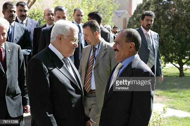 In this handout photo provided by the PPO Yemen President Ali Abdullah Saleh meets with Palestinian president Mahmud Abbas during a meeting at the...