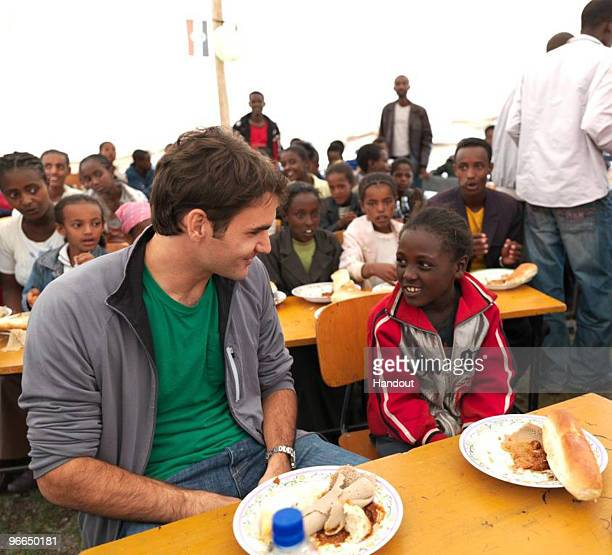 In this handout photo provided by the Roger Federer Foundation World tennis number one Roger Federer visits local school children during his visit to...