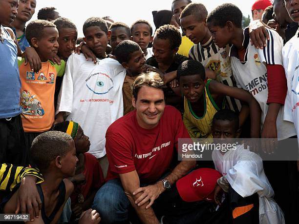 In this handout photo provided by the Roger Federer Foundation World tennis number one Roger Federer poses with local school children during his...