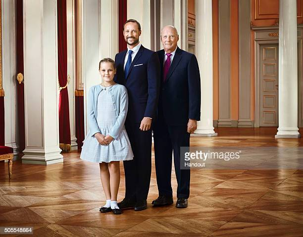 In this handout photo provided by the Royal Court Princess Ingrid Alexandra of Norway Crown Prince Haakon of Norway and King Harald V of Norway pose...
