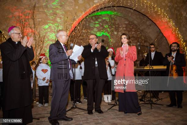 In this handout photo provided by the Royal Hashemite Court Queen Rania of Jordan takes part in the lighting of the Christmas tree on December 16...