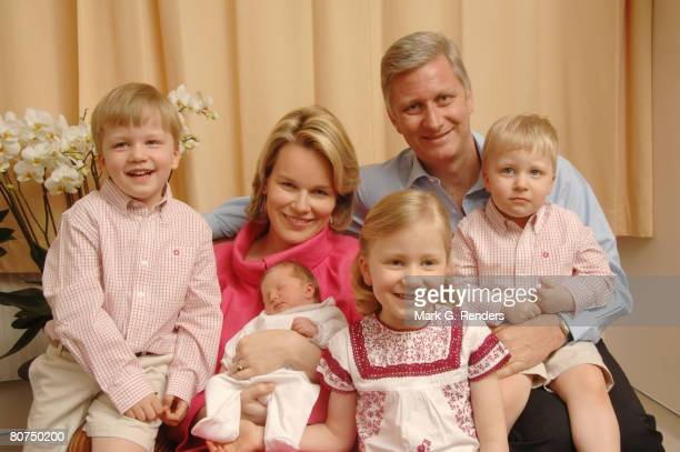 In this handout photo provided by the Royal Palace Princess Mathilde and Prince Philippe of Belgium pose for a photo with newborn baby daughter...
