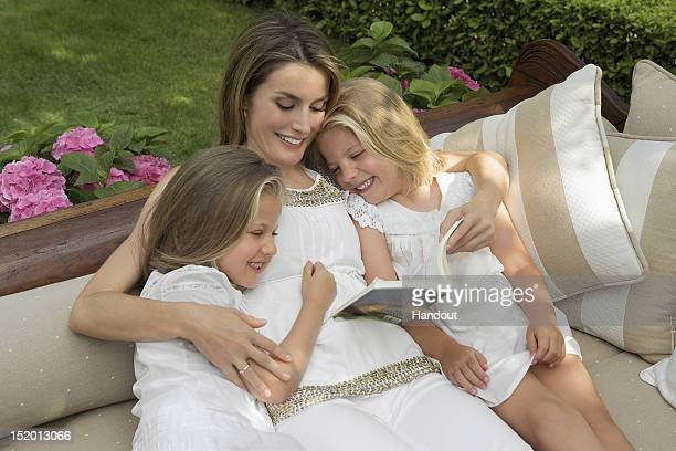 In this handout photo provided by the Royal Press Department Princess Letizia of Spain and children Princesses Leonor and Sofia pose at Zarzuela...