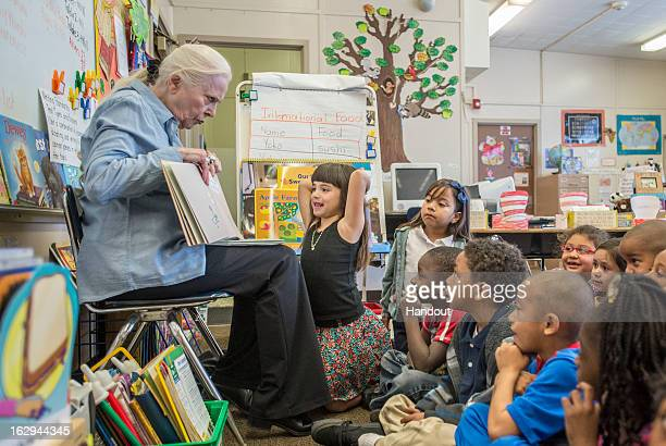 In this handout photo provided by the Screen Actors Guild Foundation 5yearold Jasminen Alcaraz enjoys the story as Barbara Bain founder of the SAG...